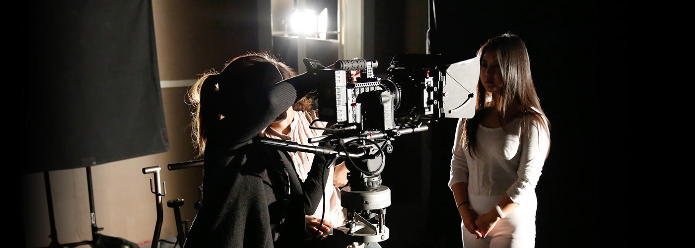 New York Film Academy producing students set up a shot with an actor in white.