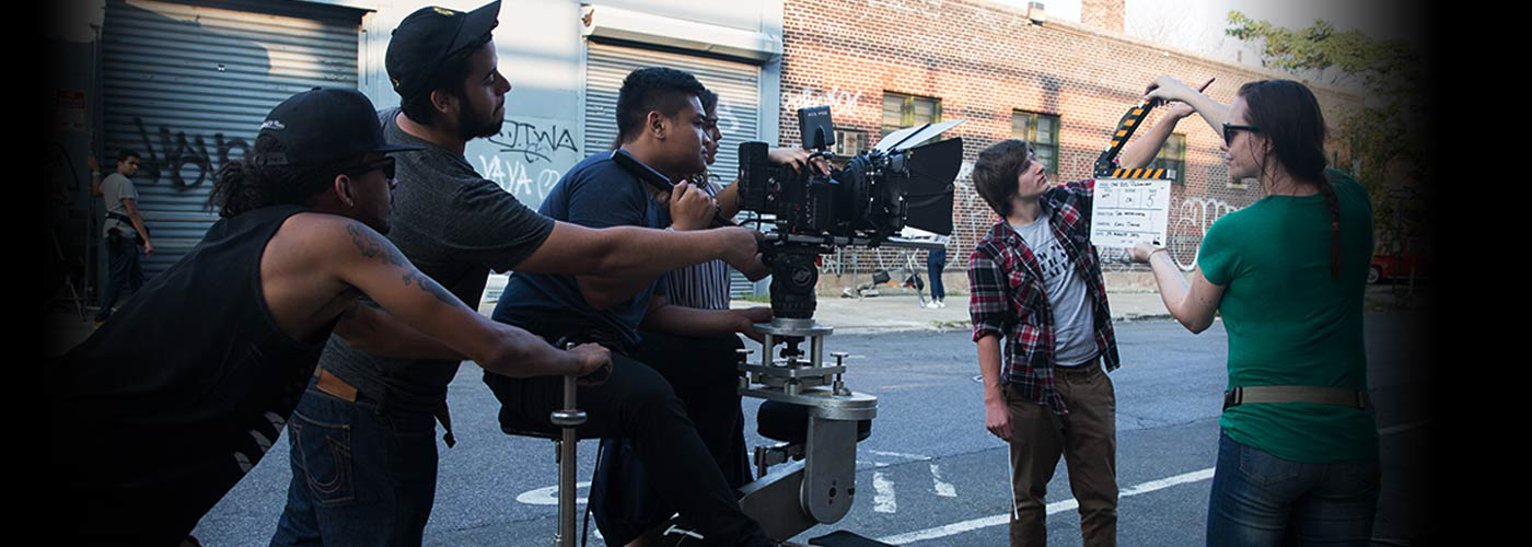 New York Film Academy producing students slate for a take on location in city streets.