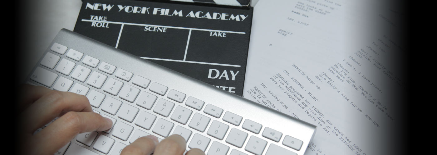 Closeup of NYFA screenwriting students hands on keyboard, over a screenplay and a film slate.