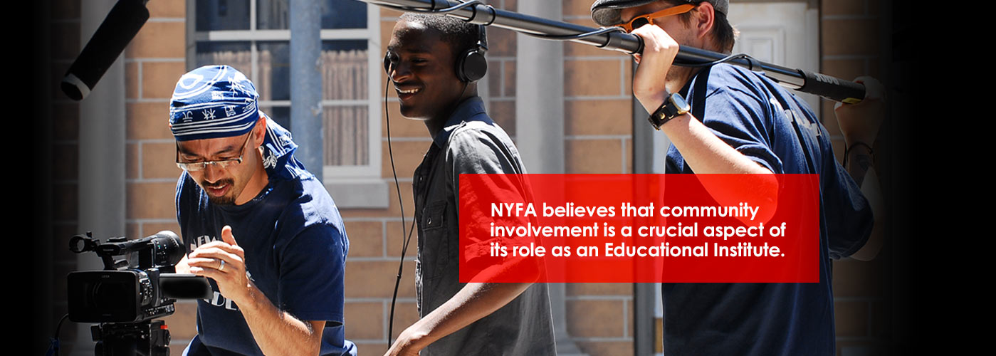 Smiling NYFA special projects students film a special project scene outside, with an HD camera, boom, and headphones.