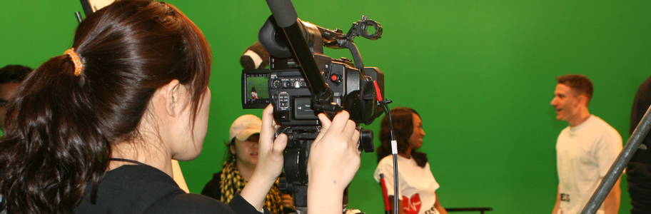 Student shoots a scene using a green screen