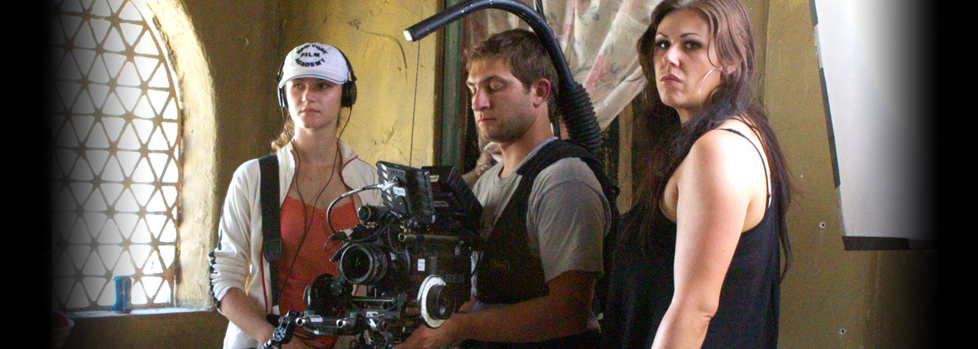 Three NYFA veteran students operate a camera