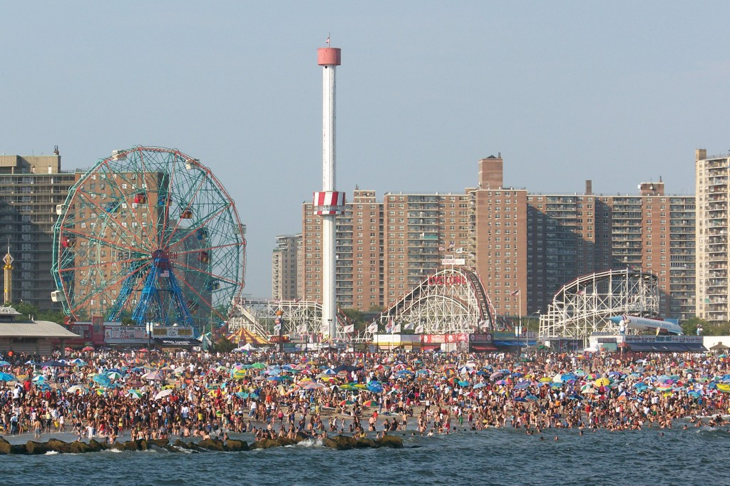 People loung on the beach at Coney Island