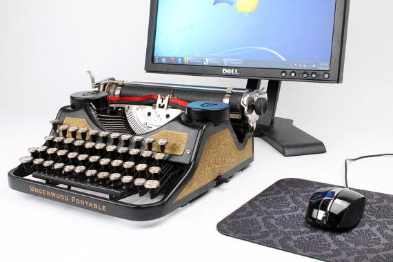 Typewriter with computer mouse and screen