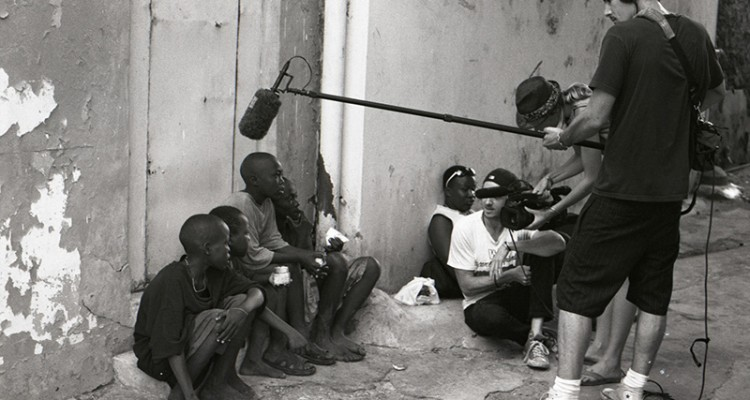 Documentary filmmakers interviewing children in the street