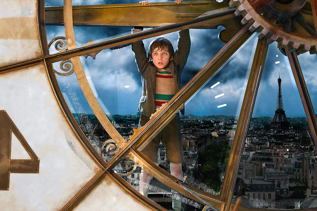 Hugo hanging from the clock in Hugo