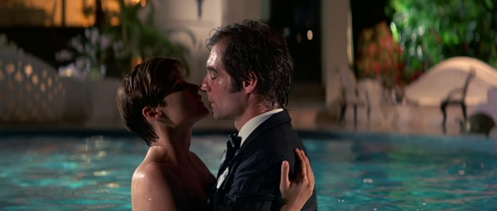 Timothy Dalton and Carrie Lowell embrace in License to Kill