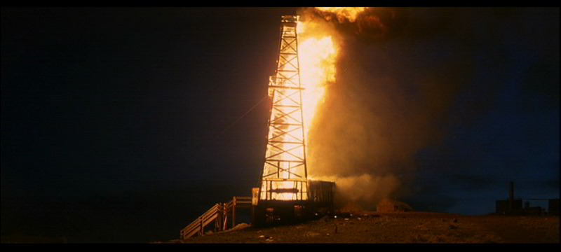 An oil derrick on fire from There Will Be Blood