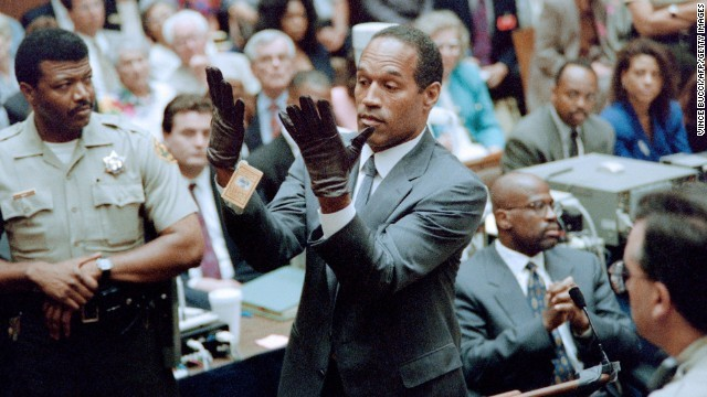 OJ Simpson trying on gloves