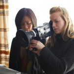 A female documentary filmmaker shoots footage