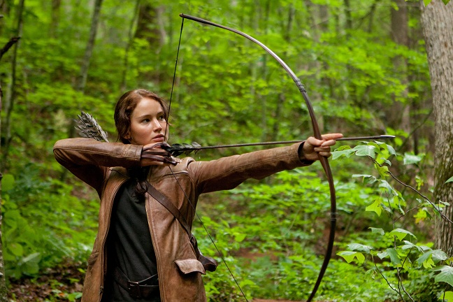 Katniss Everdeen with bow in The Hunger Games