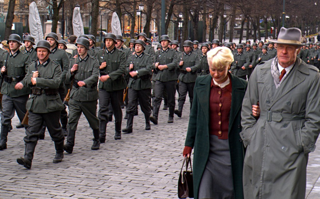 extras march during a WWII scene