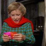 Peter Ostrum as Charlie with a Willy Wonka bar