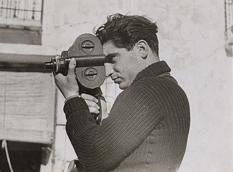 Robert Capa uses a hand-held camera