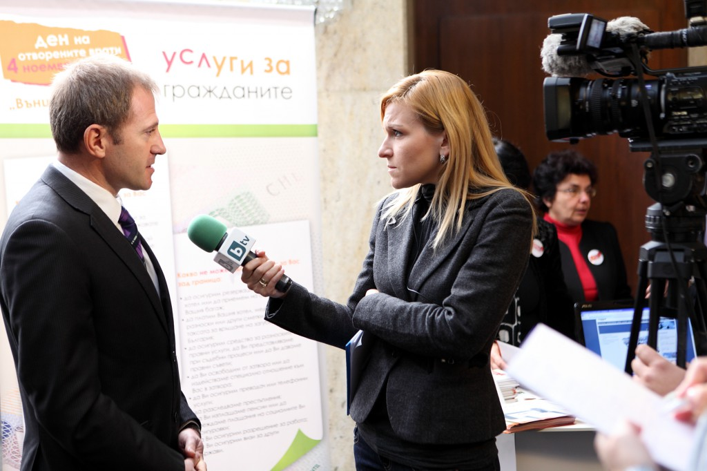 Broadcast Journalist Gabriela Naplatanova interviews on camera