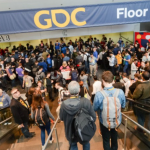 People riding the escalator at the Game Developers Conference
