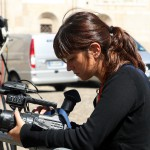 Woman setting up a camera