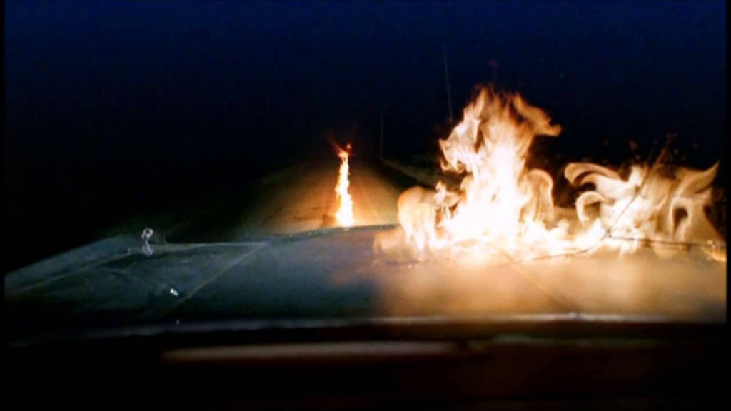 Karma Police screenshot of fire on road