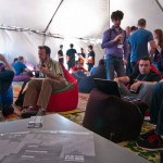 Indiecade exhibitors lounge in a booth