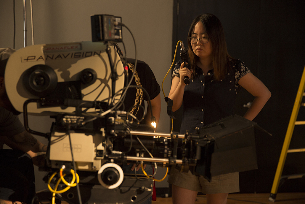 Woman setting up Panavision camera