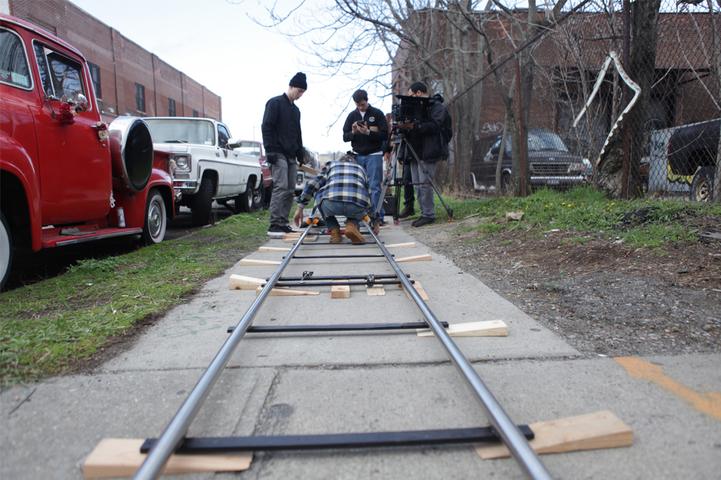 Crew members setting up set structure