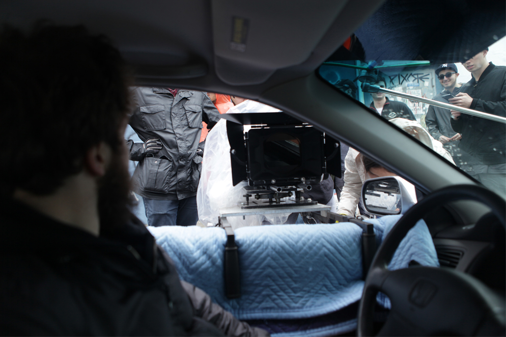 Close-up of side car camera rig from inside the car