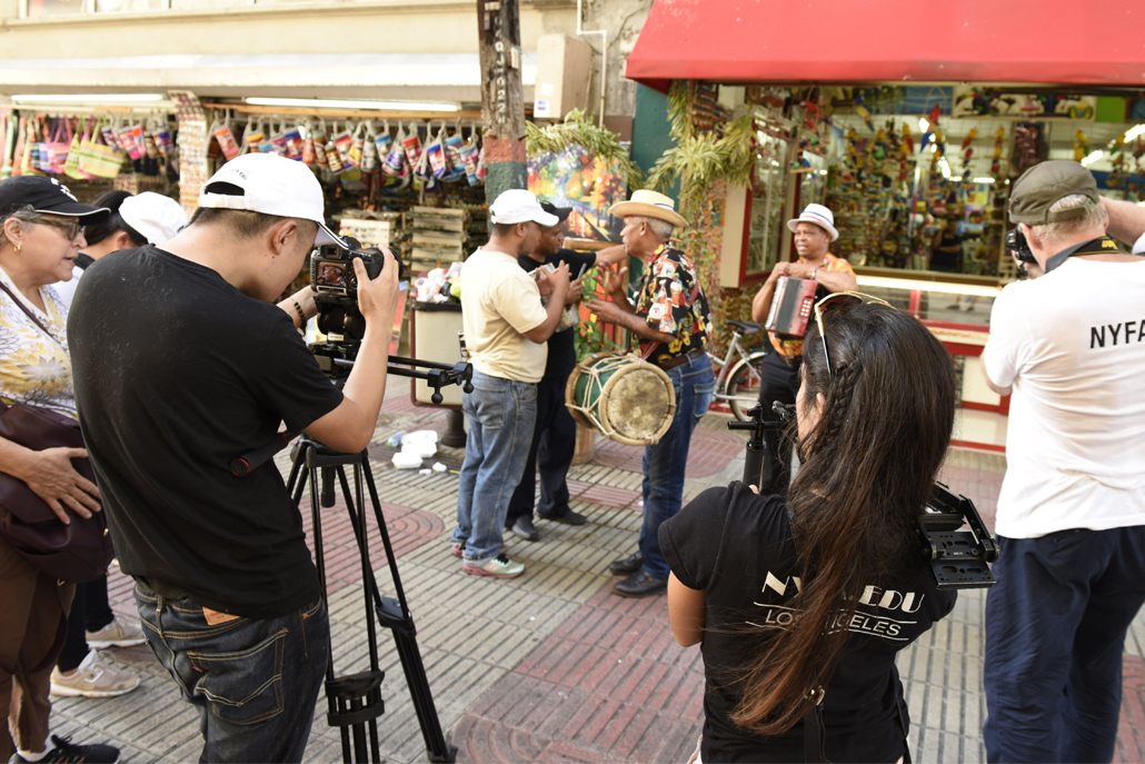 Film crew recording music performers on streets of Dominican Republic