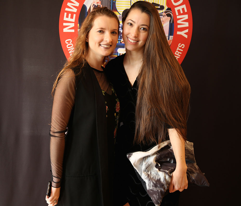 two female nyfa students at the 2016 fall film commencement ceremony