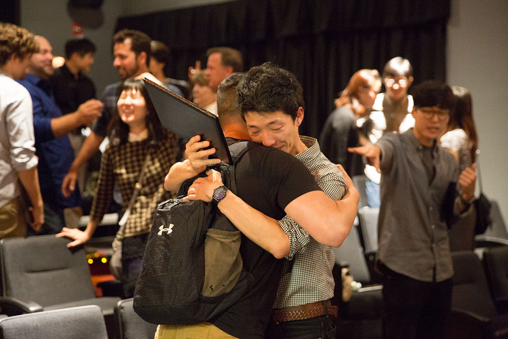 two people hugging at the 2016 nyfa fall film commencement ceremony