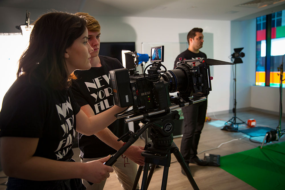 two nyfa students looking through camera