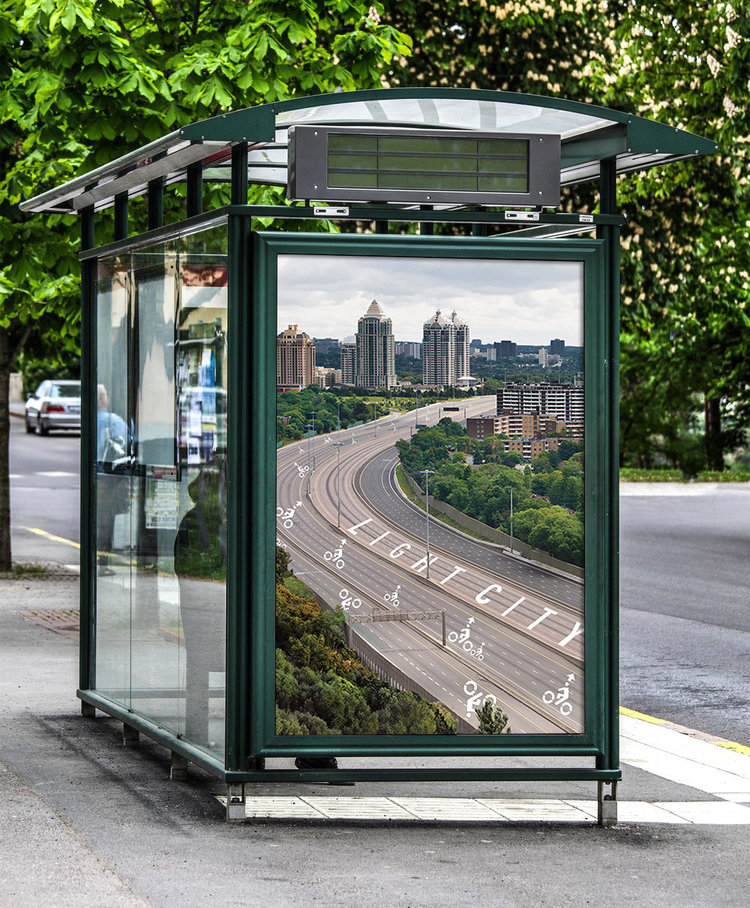 A billboard of the bike highway on a bus stop