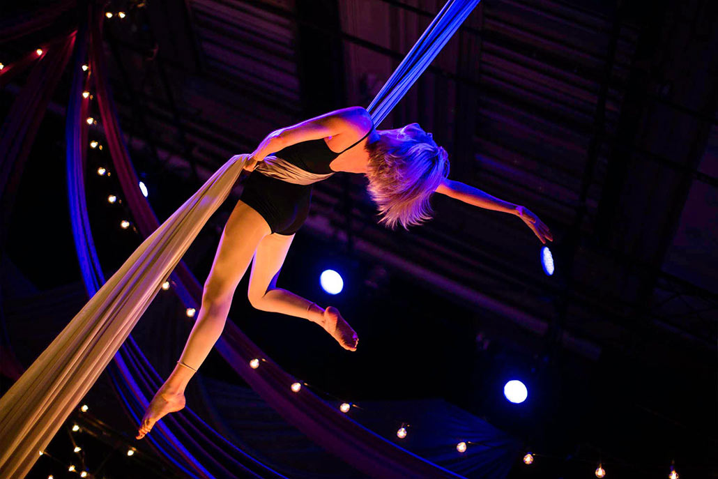 girl hanging from rope performer