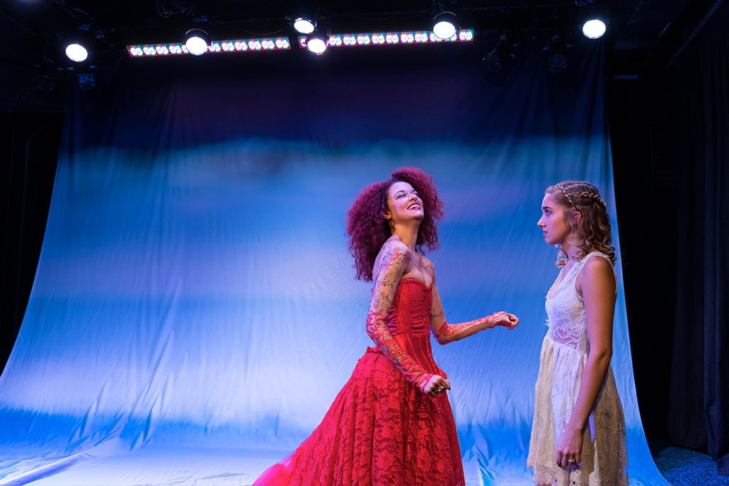 New York Film Academy musical theatre students in red and white lace dresses perform Eurydice.