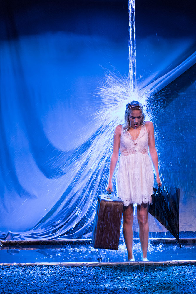 NYFA musical theatre student under downpour of water onstage in Eurydice.