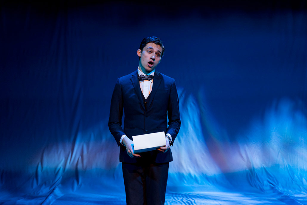 NYFA musical theatre student in black suit and bow tie sings in Eurydice.