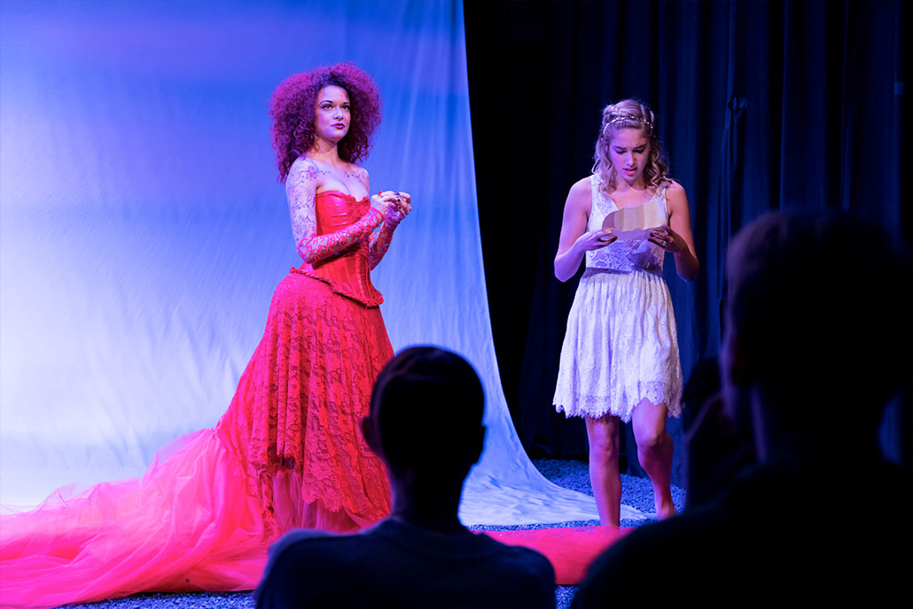 NYFA musical theatre student in glamorous red lace costume performing in Eurydice.