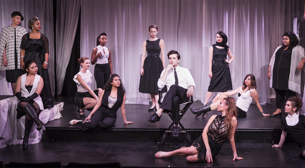 Nine Cast Pose On Stage