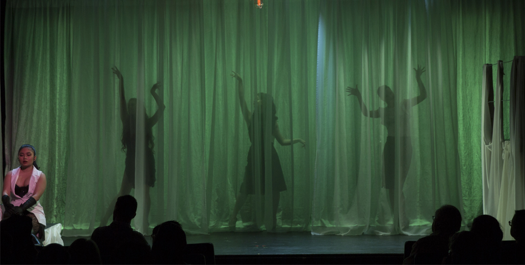 Nine Three Female Performers Behind Curtain