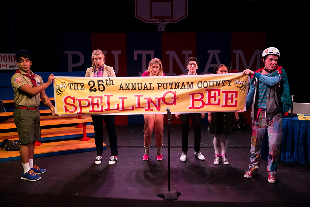 NYFA musical threatre student ensemble displays sign for The 25th Annual Putnam County Spelling Bee.