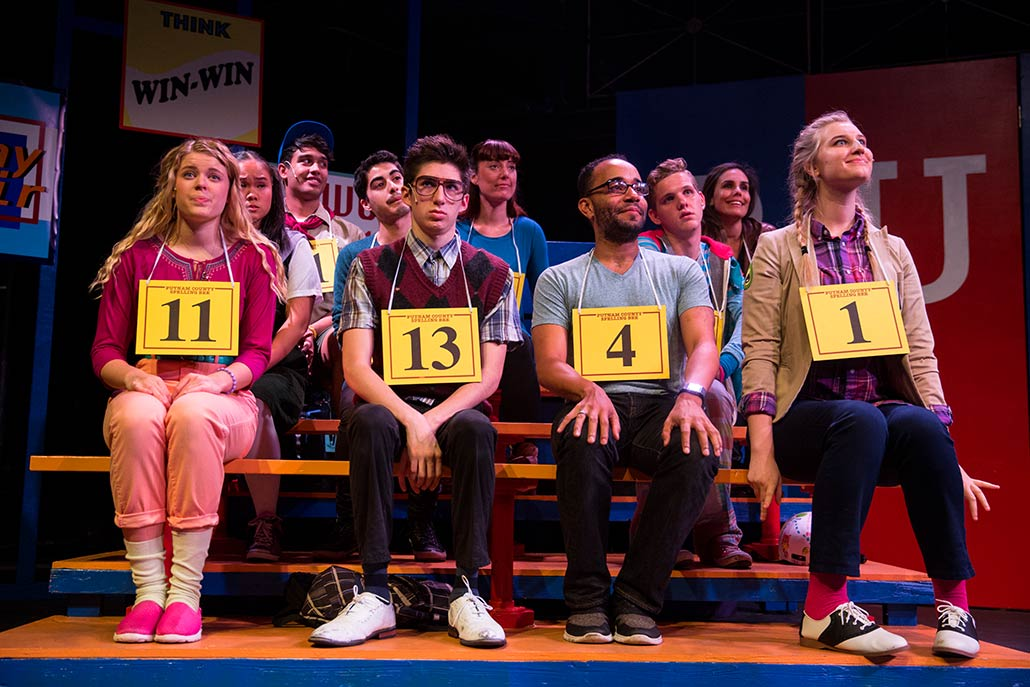 NYFA musical theatre student ensemble siting in bleachers in scene from Spelling Bee.