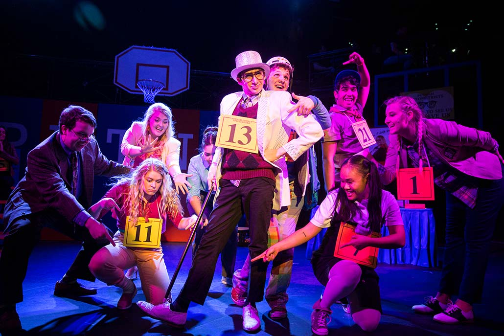 NYFA student ensemble poses for grand finish of musical number in Spelling Bee.