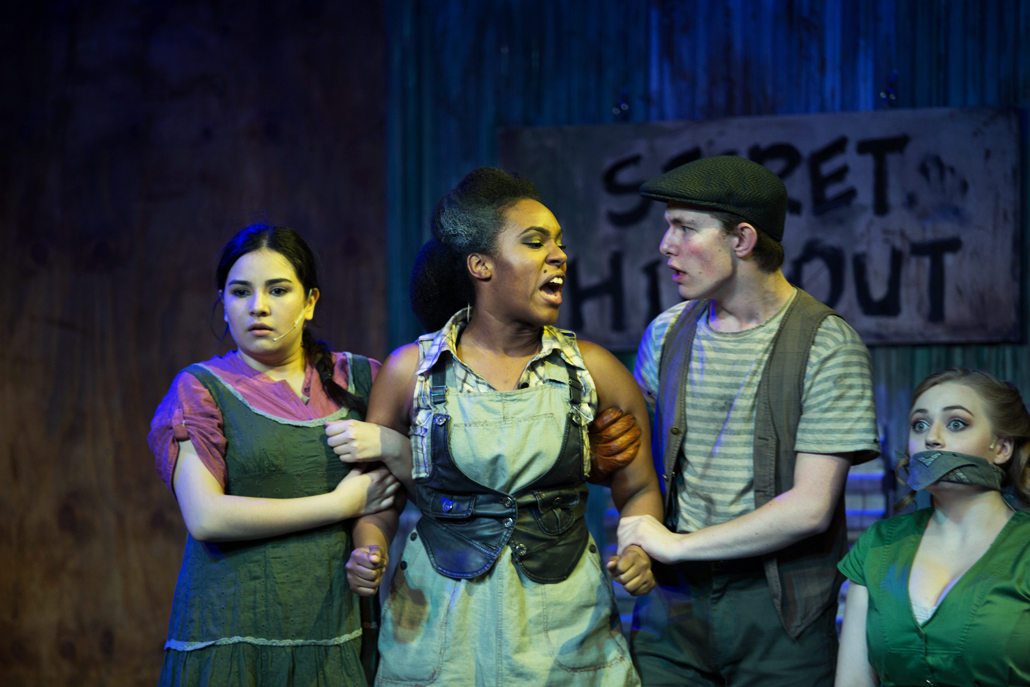 Urinetown Cast Hold Member Back