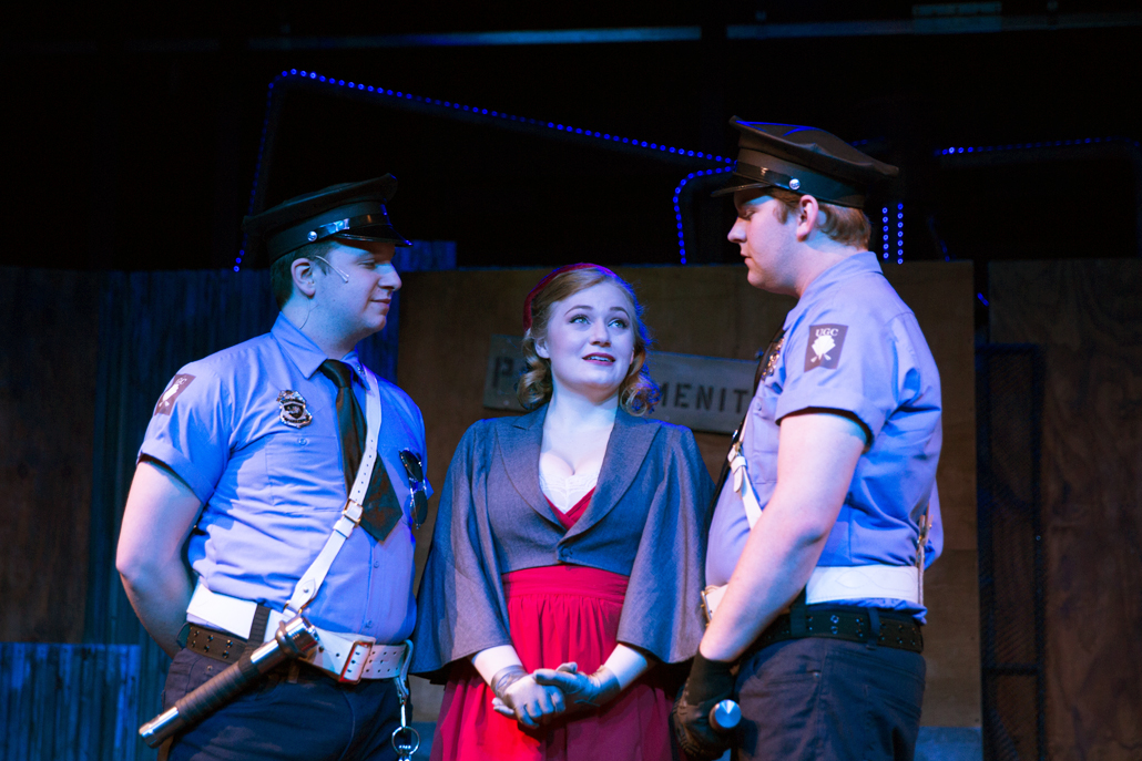 Two Urinetown Police Officers