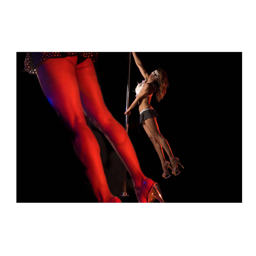 Woman dancing on pole with close up on legs