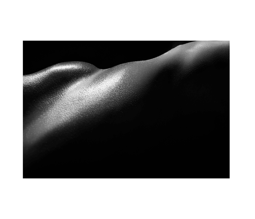 Black and white upclose photo of side of body