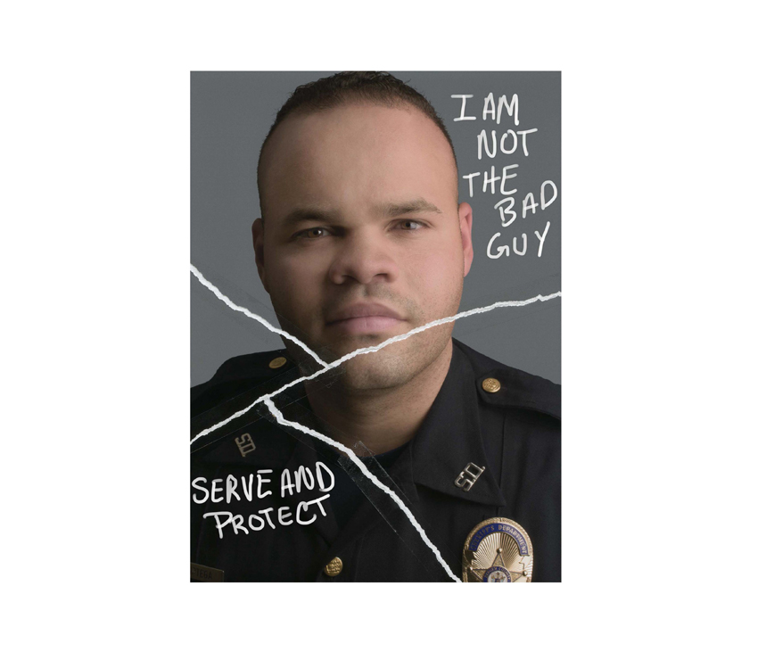 Police officer posing with 'I am not the bad guy' and 'Serve and Protect' written on top
