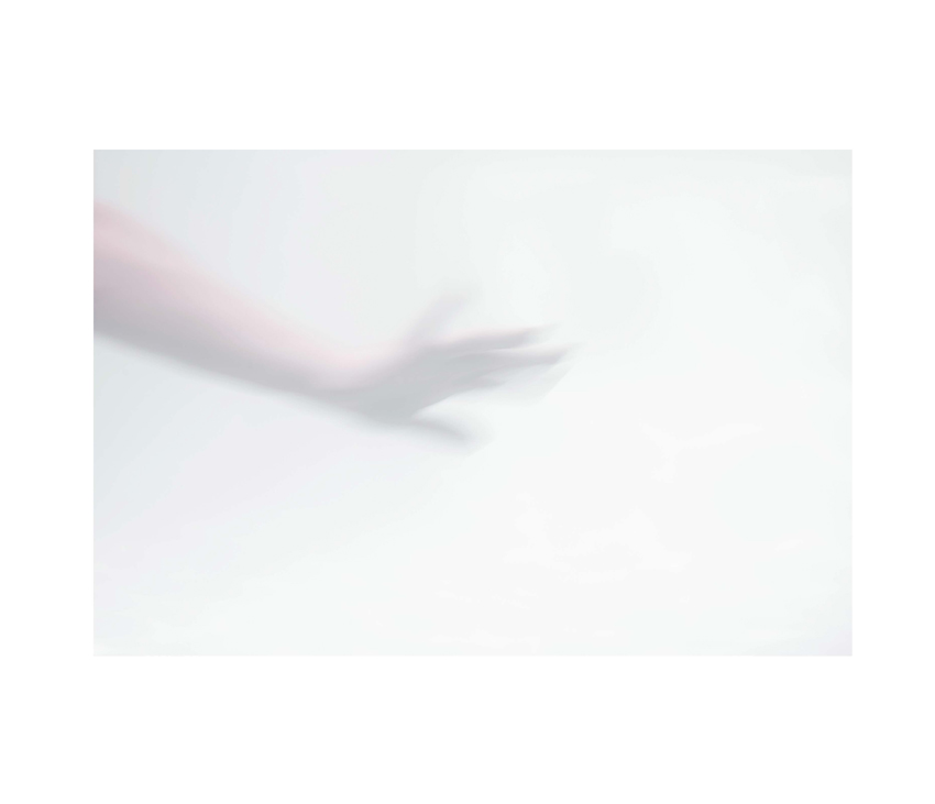 Blurred open hand on white background
