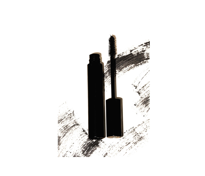 Graphic of black mascara with black and white background