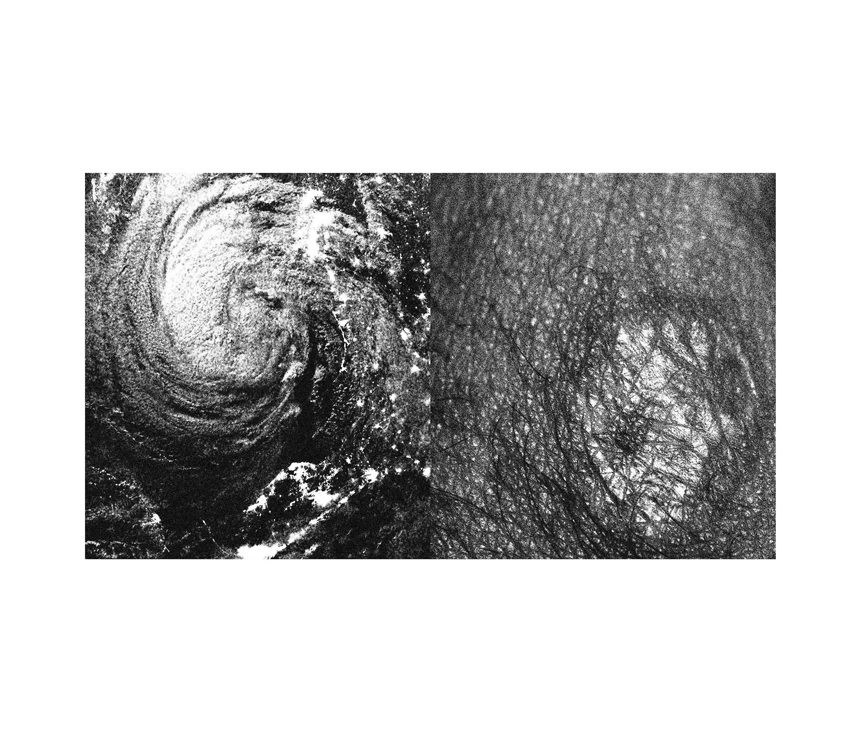 Aerial photo of hurricane next to rocky landscape
