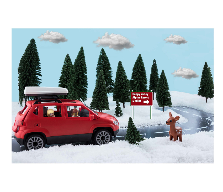 Animated red car driving up snowy hill with Lego characters inside